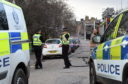 Castlehill Road in Forres is closed off due to a car leaking LPG gas