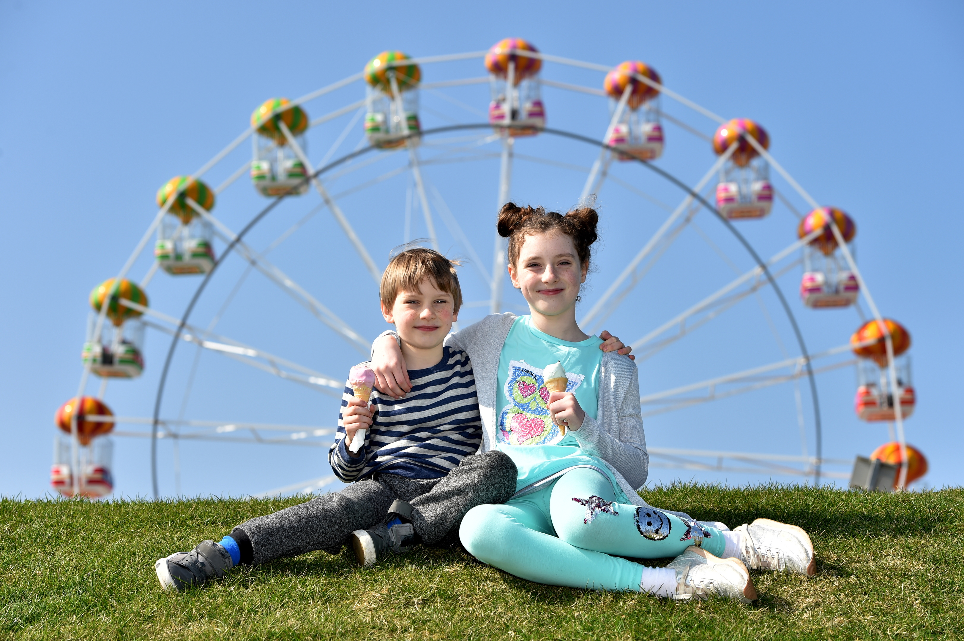 Family and friends make the most of the warm sunshine at Aberdeen Beach. last month Picture of Dorlian, 7, and Hanna Lipka, 9, enjoying icecream.