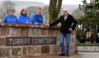 Friends of Turriff Cemetery have reached another milestone with the completion of a new wall at the entrance of the north east graveyard.     Pictured - L-R Friends of Turriff Cemetery members Annette Stephen, Morag Lightning, Fraser Watson with the builder Brian McAllister.
