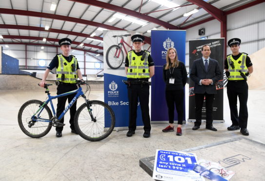 """Launch of Police Scotland's annual initiative to tackle bike crime in Aberdeen, """"Operation Lathe"""" at Transition Extreme.     Pictured - L-R PCBlair Todd, Sgt Craig Murray, Linzi Harrow of Transition Extreme, Cllr Martin Greig and PC Rory Saunders.     Picture by Kami Thomson    16-04-18"""