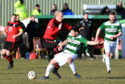 Loco's Chris Angus and Buckie's Andrew Skinner in action.