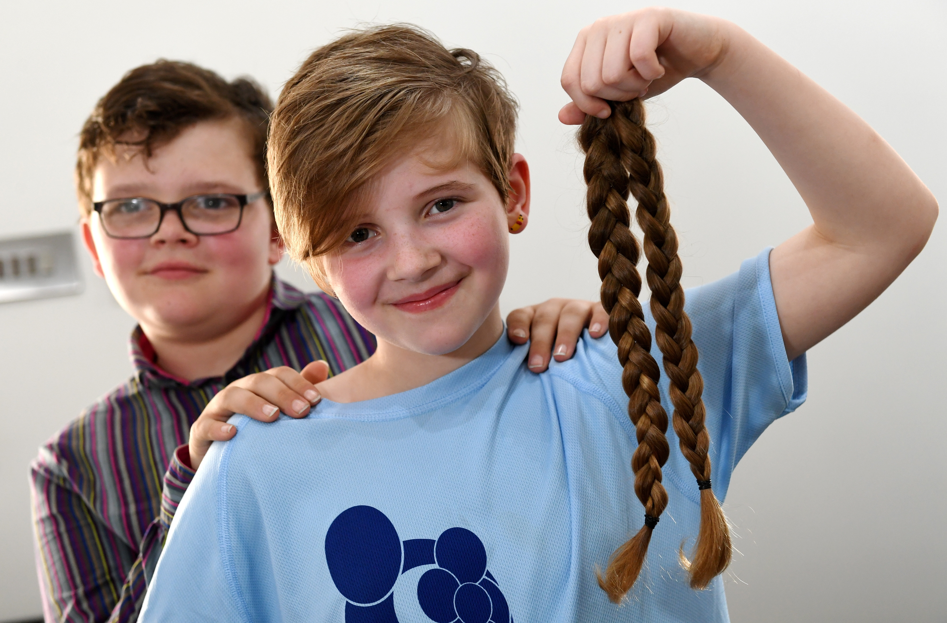 10-year-old Leighann Milne with her brother William after the haircut