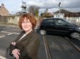 Councillor Angela MacLean at the crossing in Dingwall.