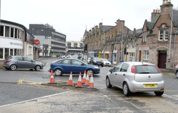 Traffic moves freely yesterday after the traffic lights at the junction of Tomnahurich Street and Kenneth Street in Inverness were damaged in an accident. Picture by Sandy McCook.