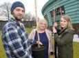 Lynda Fraser (centre) with her son Conrad and daughter Samantha help family members plant seven commemorative trees in the grounds of Maggie's Highland in Inverness in memory of her husband and their father Stuart who died in December.