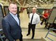 MP Drew Hendry with Depot Manager David Noble in the current sorting office yesterday. Picture: Sandy McCook