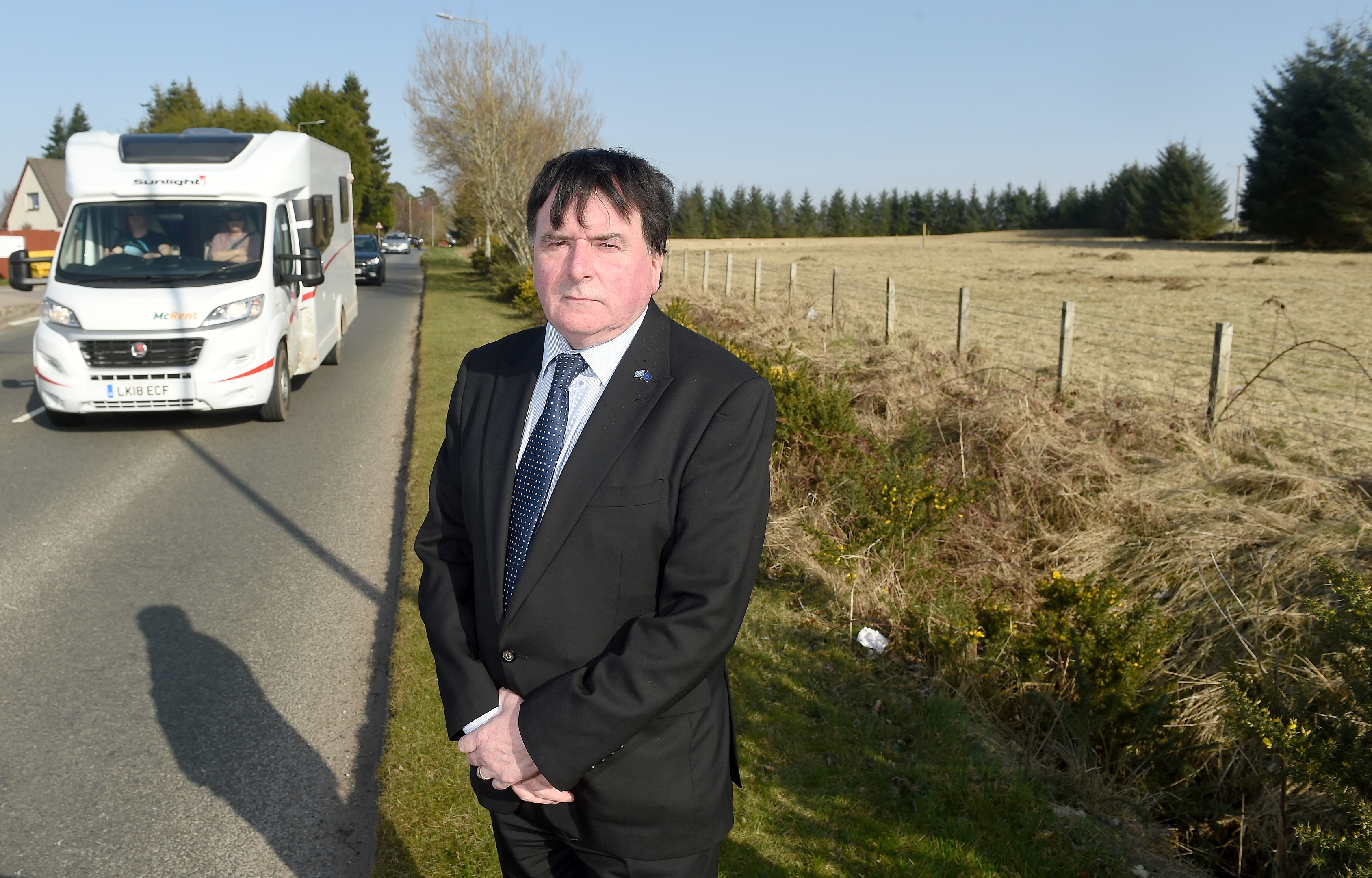 Inverness Councillor Ken Gowans at the site of the contentious planning application