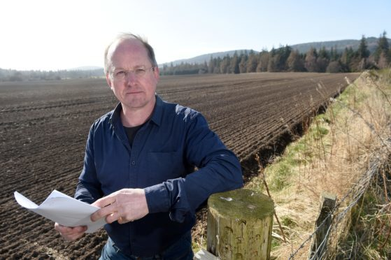 Inverness based architect Neil Sutherland on the site at Novar in Evanton