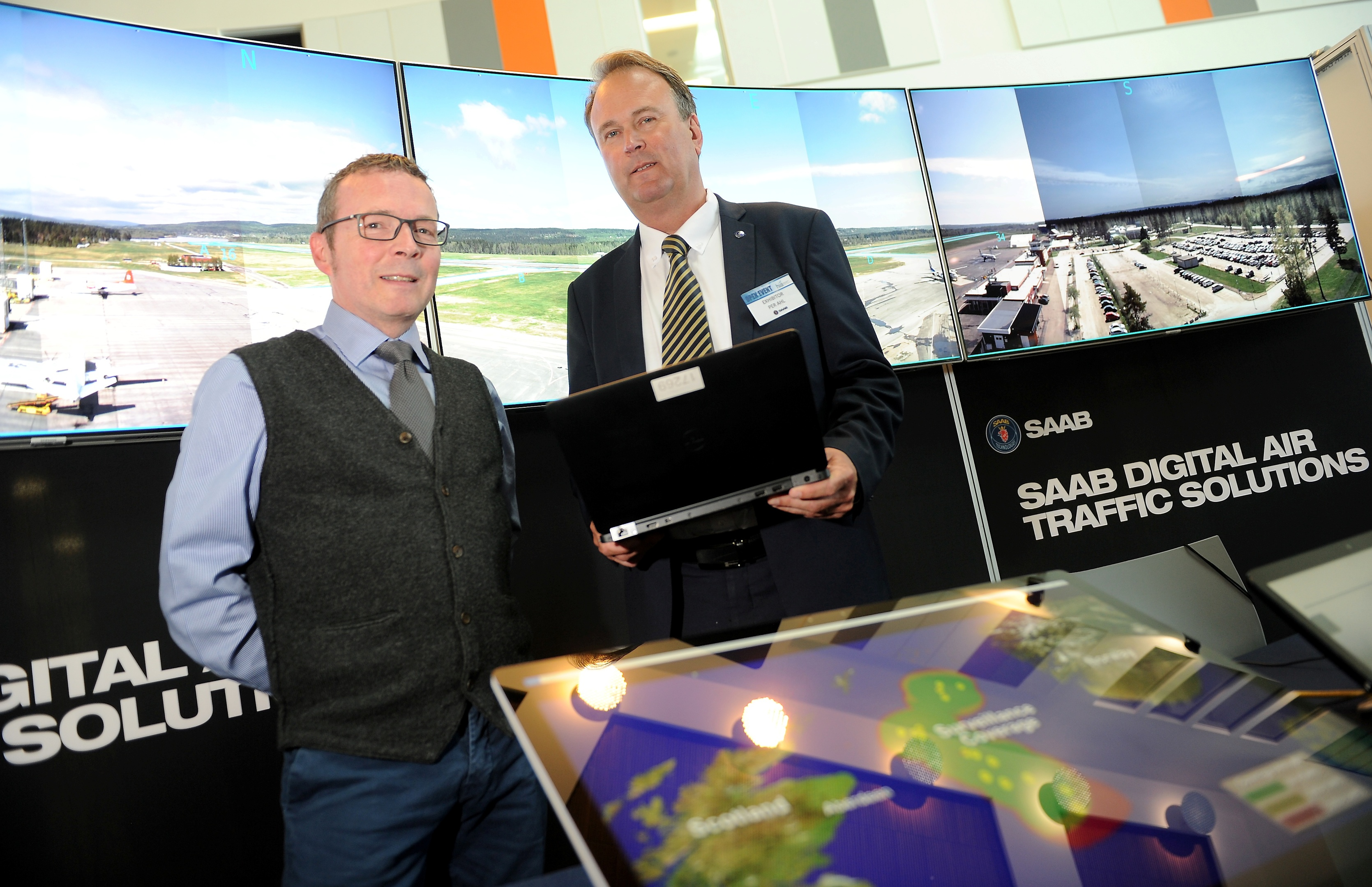 Inglis Lyon (left) Managing Director of HIAL with Per Ahl of Saab as the company demonstrates its use of digital control towers at an exhibition in Inverness yesterday. Picture by Sandy McCook.