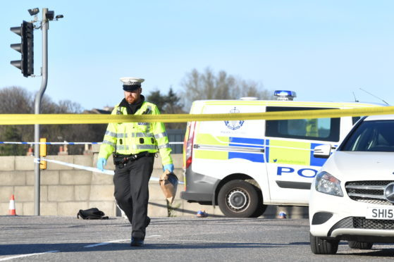 Police at the scene earlier today.