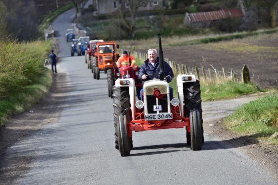 Members of the Buchan Vintage Tractor Club on their annual charity run through the Buchan countryside.