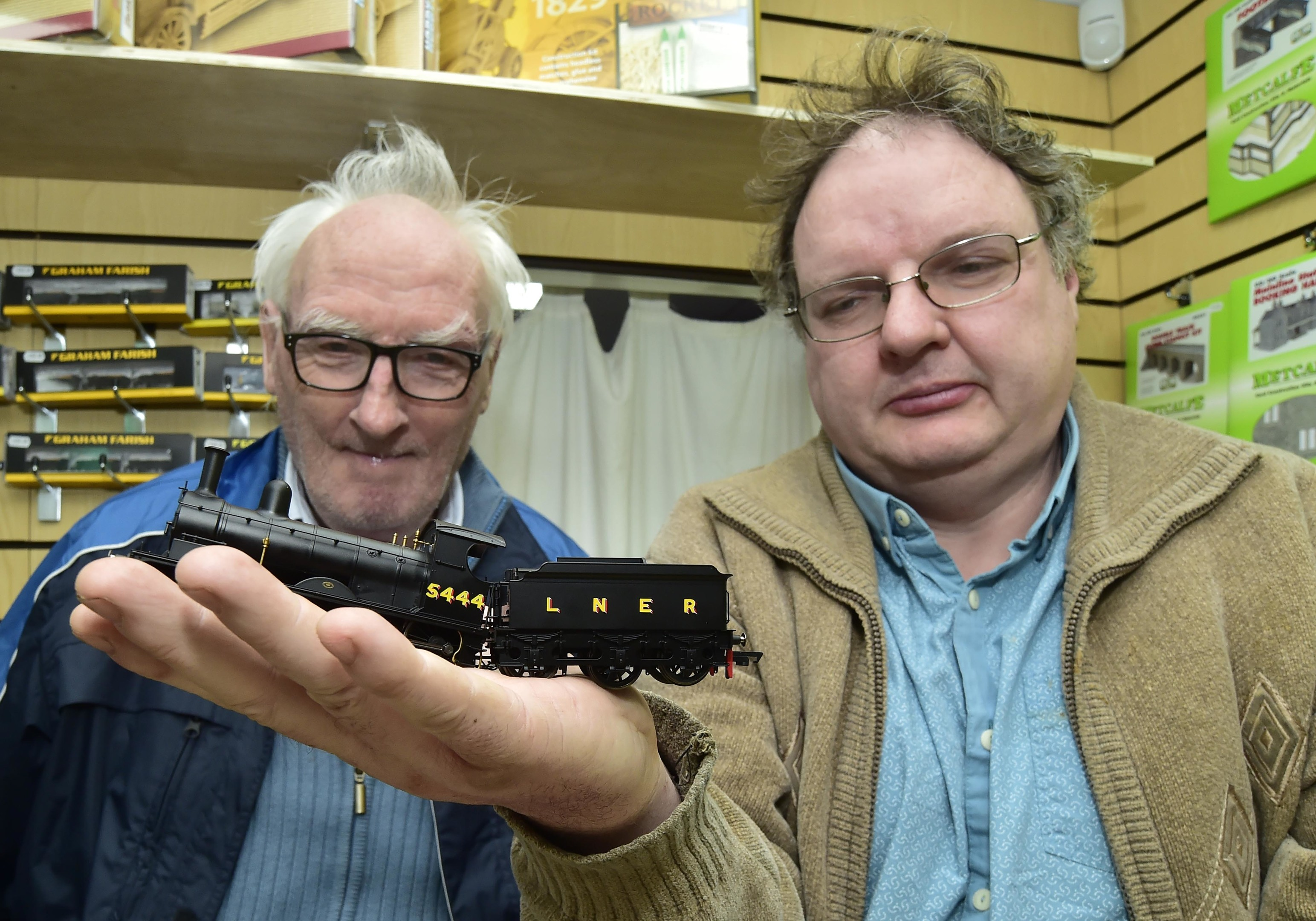 Bill Scatterty (L) and Gordon Kirtley of the North-east Heritage Railway with a model steam train.they are hoping to restore the real thing to the north-east.