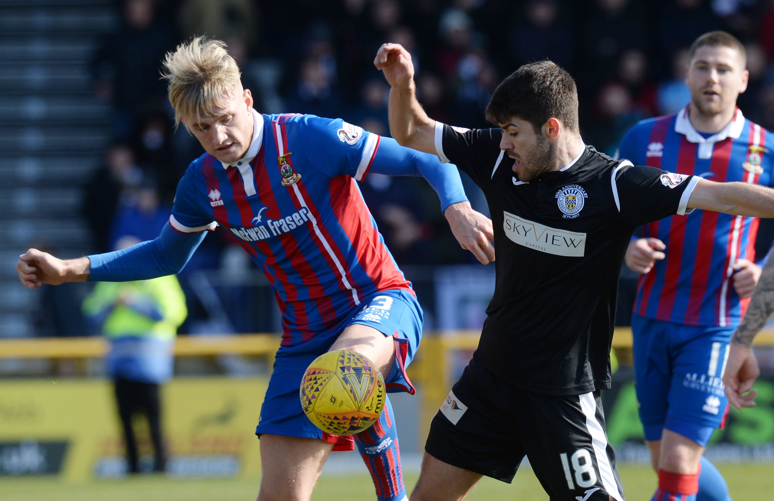 Inverness' Coll Donaldson and St Mirren's Ryan Flynn battle for possession.
