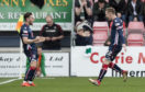 Ross County's Billy McKay (R) celebrates his goal against Hibs with Alex Schalk.