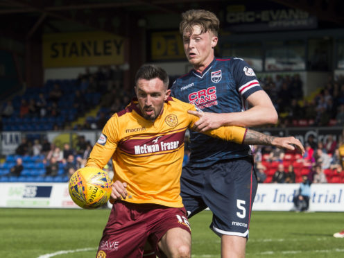 Motherwell's Ryan Bowman (L) in action against Ross Countys Harry Souttar