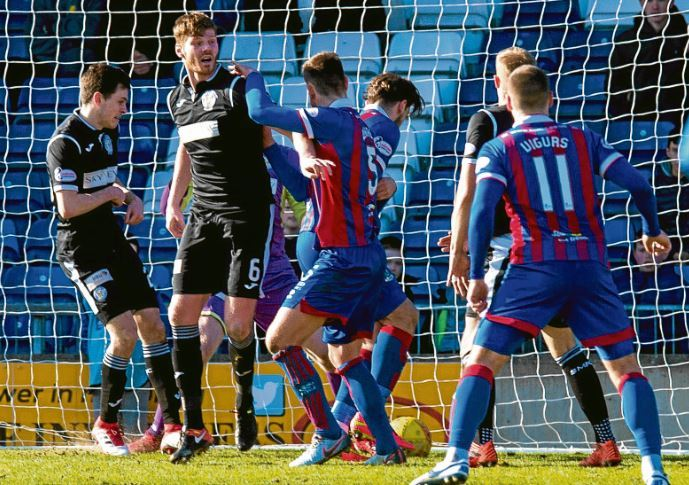 Inverness defender Gary Warren, third from right, prods the ball in to kick-start Caley Thistle's recovery against St Mirren on Saturday
