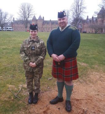 Sgt Georgi McMinn and Major Ross Munro at Cameron Barracks   Air Cadet becomes first Senior Drum Major.