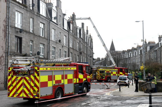 Fire and police crews attending a roof fire on a flat on Victoria Road, Torry.