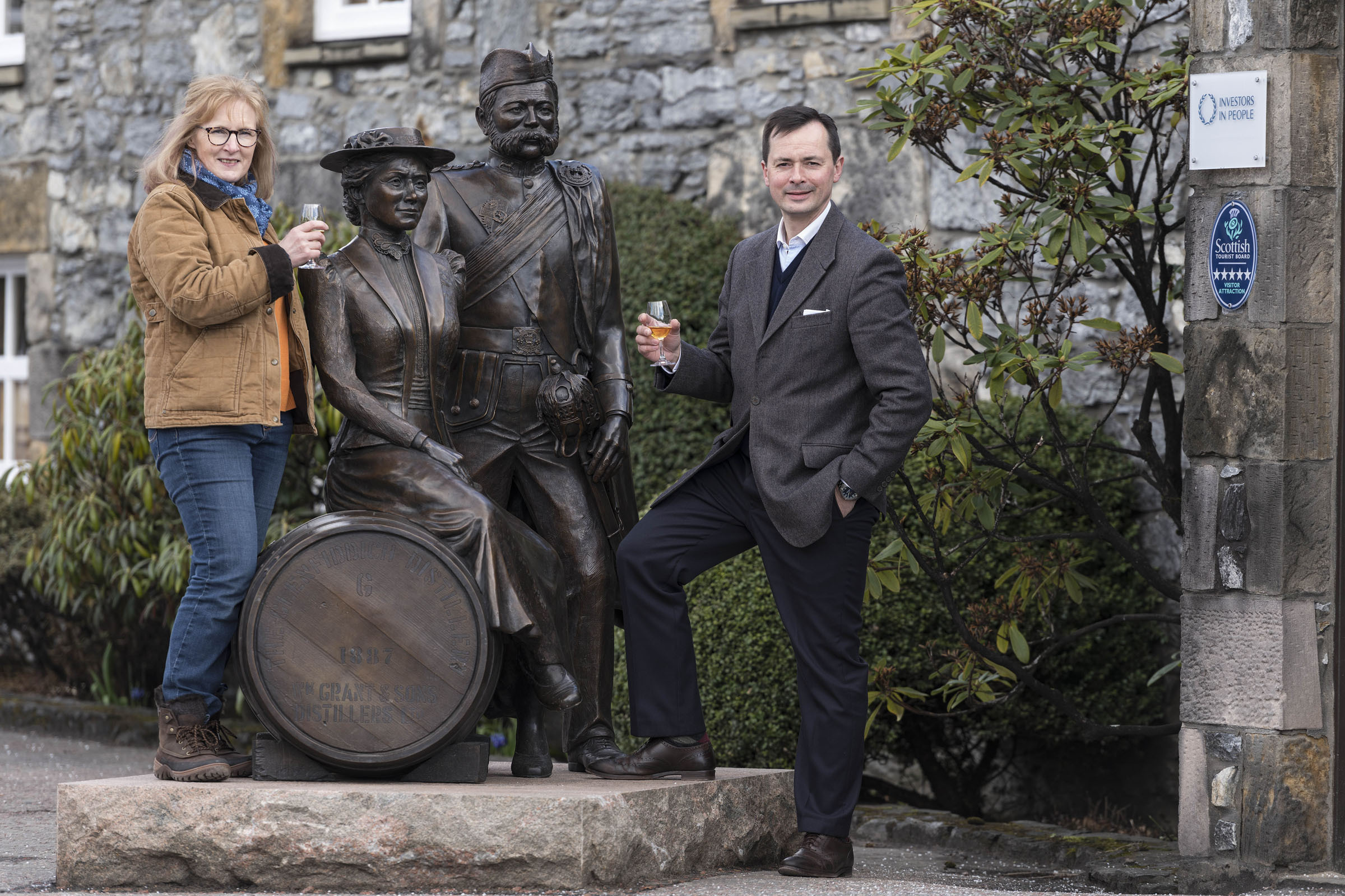Artist Lois Carson and Peter van Peborgh-Gooch, general manager of William Grant and Sons' visitor centres, raise a glass to Glenfiddich's founders.