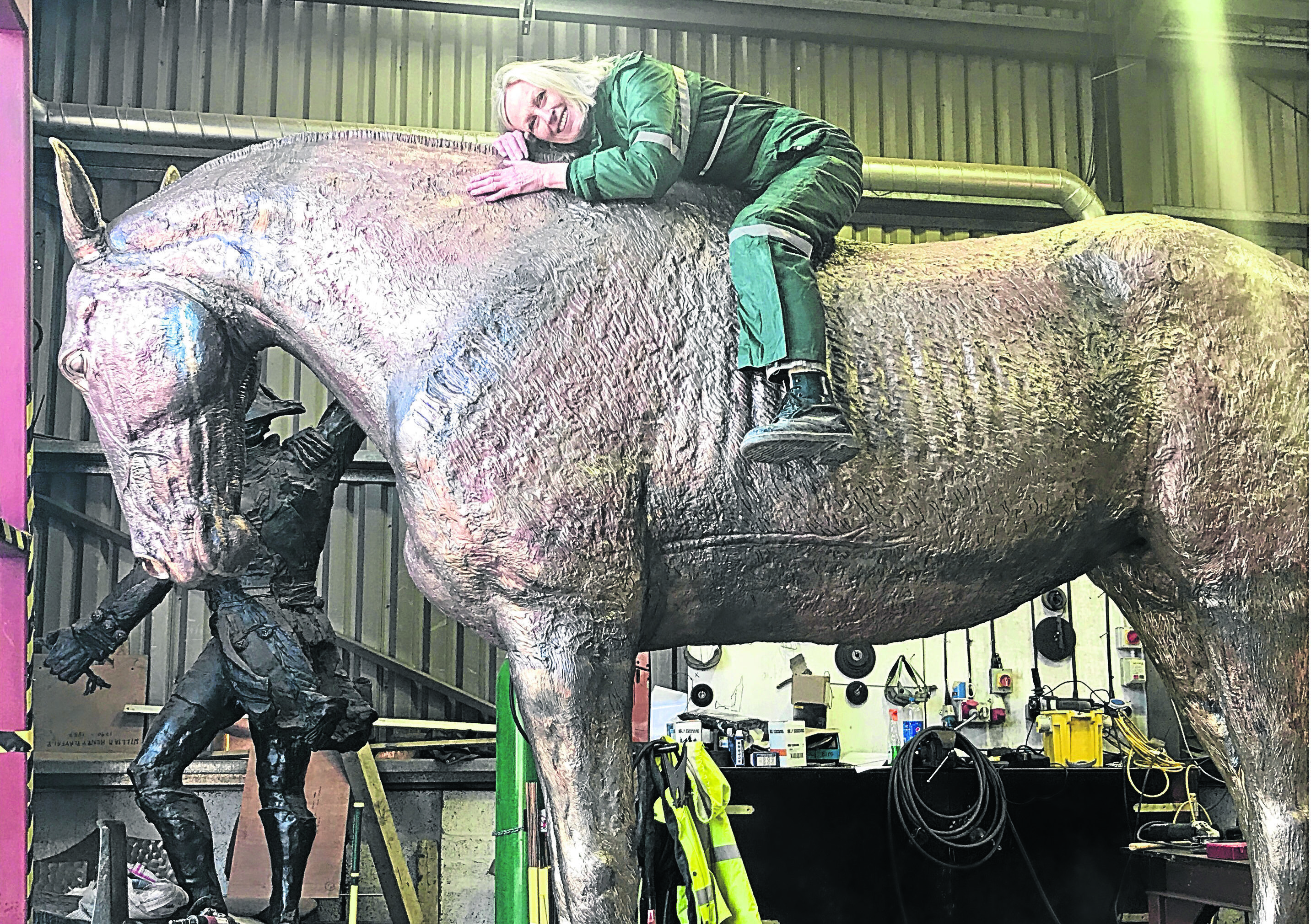 The sculptor Susan Leyland on the horse.