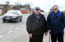 Residents worried about the speeders on Kinmundy Road, Peterhead. In the picture are Councillor Alan Buchan, left and resident, George Wilkinson.