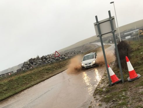 The Coast Road, which links Torry and Cove, was hit by overflows of water during heavy rainfall earlier this week leaving commuters driving through deep puddles on the way to work.