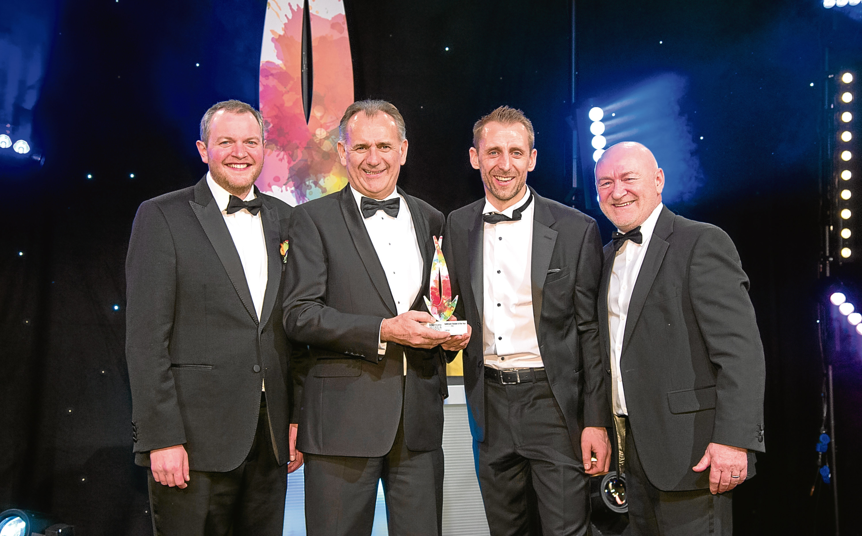 From left: awards host Miles Jupp, Andy Walker and Darren Walker, of Laings, and Ivan Wain, from Roca