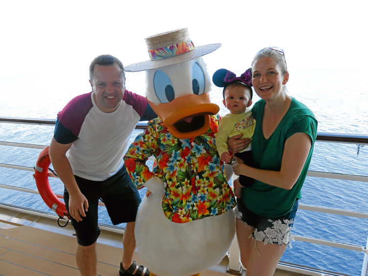 Wesley Johnson meets Donald Duck on board the ship with his wife Carla and daughter Evie