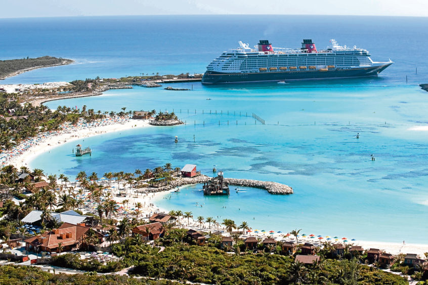Castaway Cay, Disney's private island in the Bahamas, with the Disney Dream cruise ship in the background