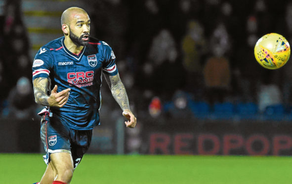 Liam Fontaine in action for Ross County.
