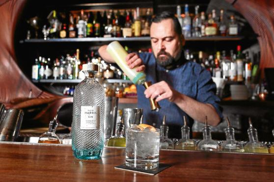 TORONTO, ON - APRIL 7: Vince Pollard poses with a flavoured gin and tonic at Bar Raval        (Andrew Francis Wallace/Toronto Star via Getty Images)