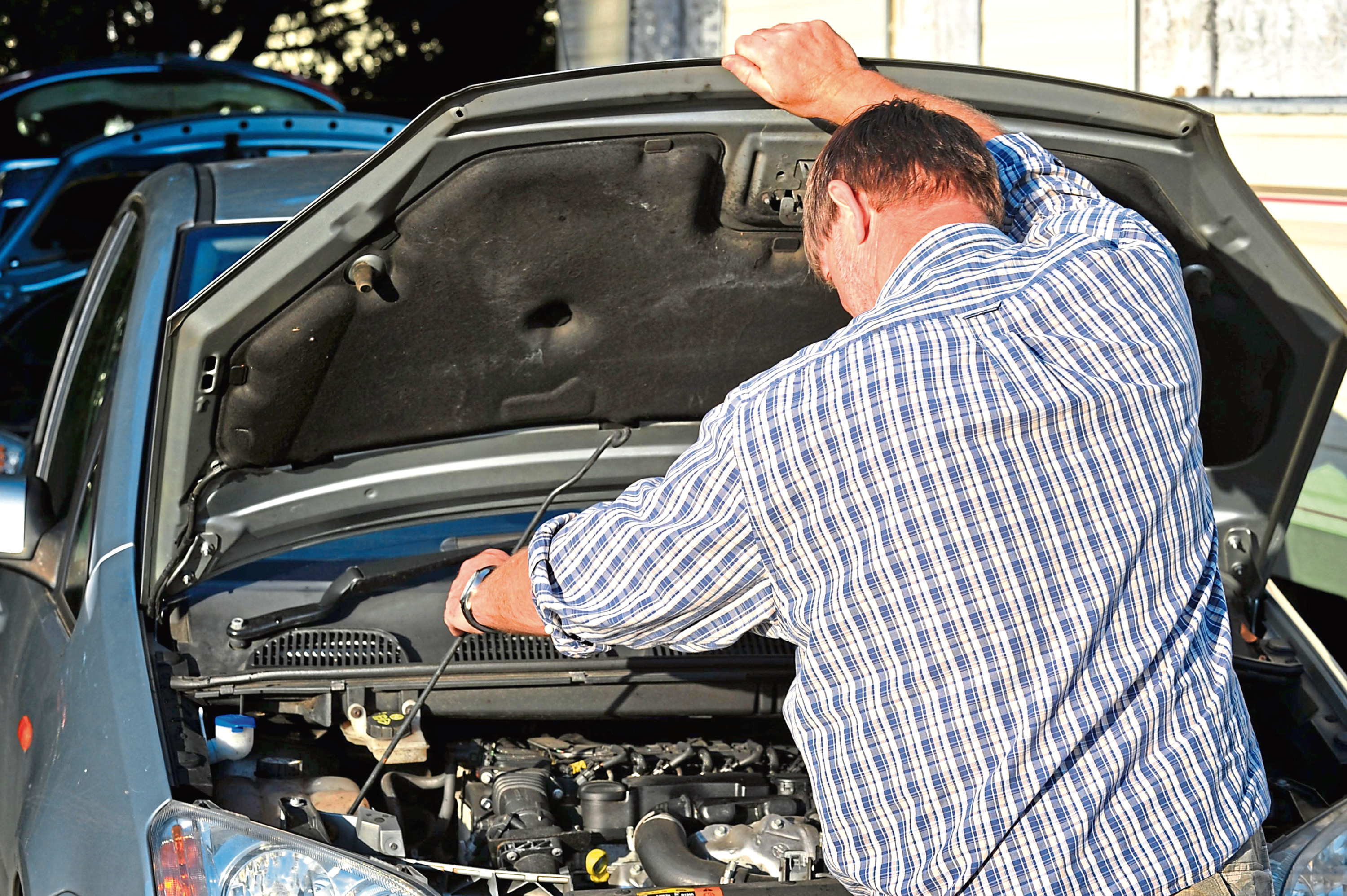 POSED BY MODEL    File photo dated 06/10/11 of a man looking under the bonnet of a car in London. PRESS ASSOCIATION Photo. Issue date: Thursday October 27, 2011. Changes to the frequency of MOT tests for cars could lead to more than 250 additional road deaths a year, campaigners said. The Government is looking at ways 'to reduce the burden' of the MOT test which is currently required annually for cars three years old or more. Possible changes to this requirement have alarmed road safety, motoring and industry groups. Today, 25 organisations joined forces to launch a campaign to get the Government to rule out reducing the frequency of MOT testing. The campaigners fear any reduction could lead to 2,200 additional serious injuries a year as well as more-expensive repairs and higher insurance bills for motorists. The organisations also say that most drivers are opposed to any MOT changes and that up to 40,000 jobs in the MOT industry, including a large number of apprenticeships, could be at risk. See PA story TRA