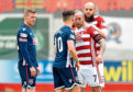 Hamilton's Dougie Imrie exchanges words with Ross County's Alex Schalk.