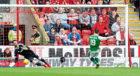 Aberdeen goalkeeper Joe Lewis saves Jamie MacLaren's first half penalty