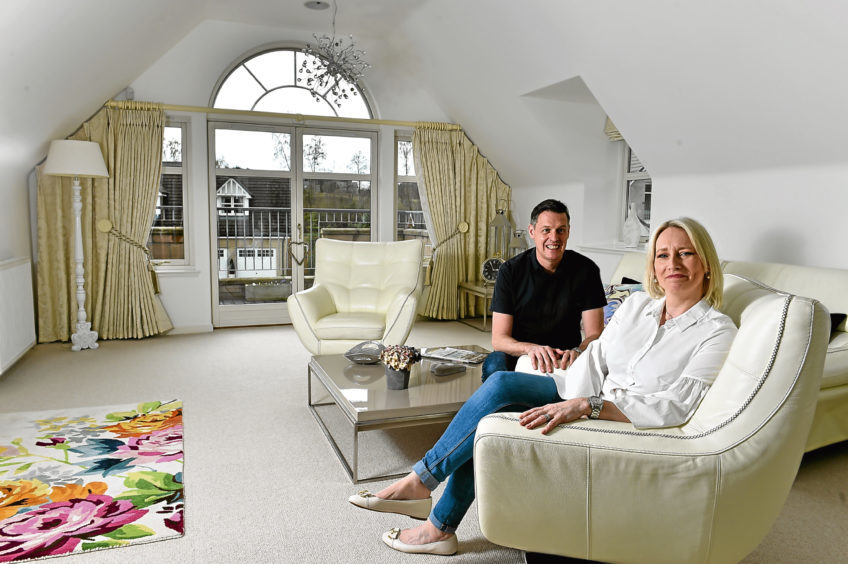 Norma and Gary Johnson in their magnificent lounge