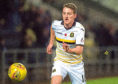 Tom Walsh in action for Dumbarton.