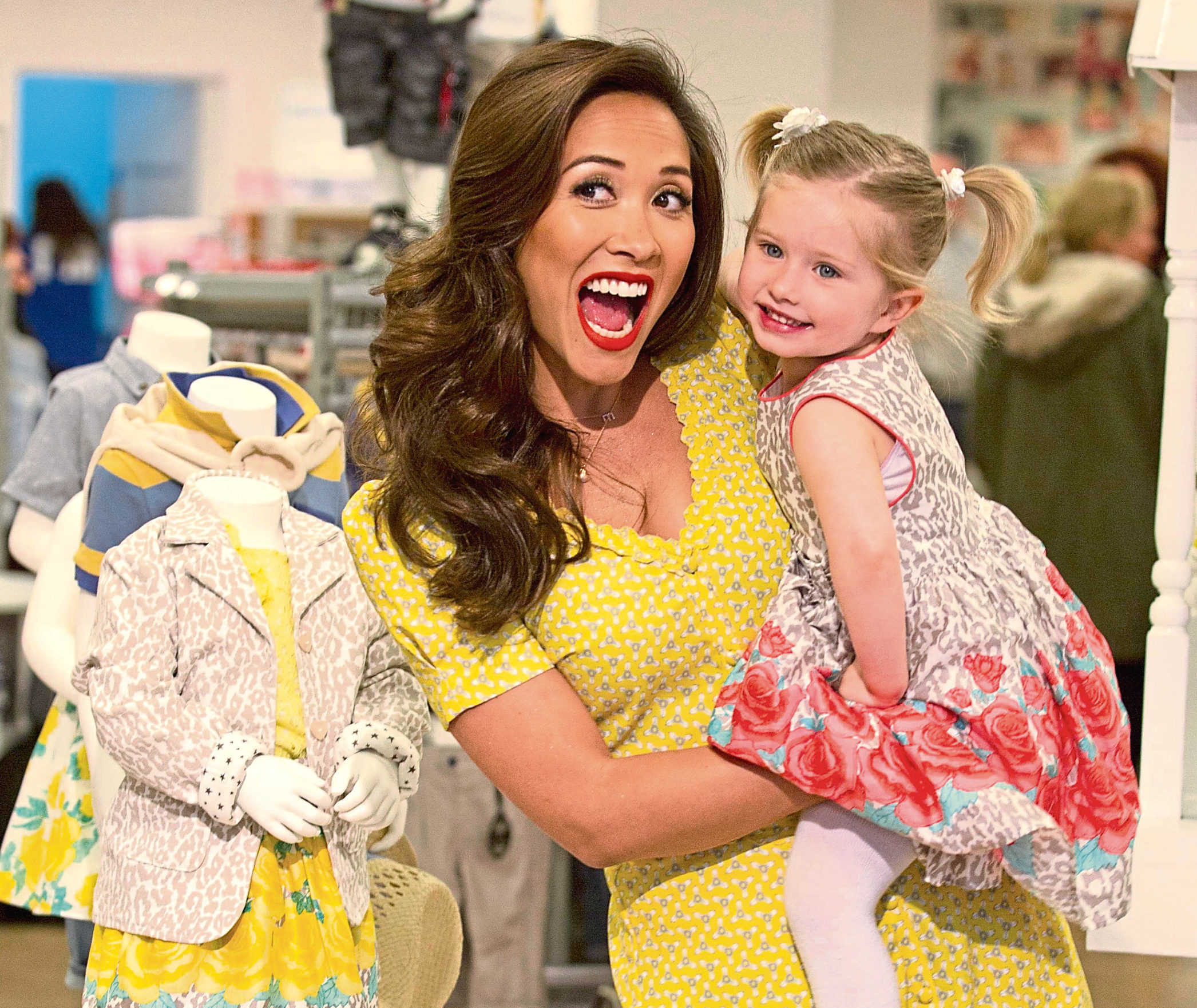 Myleene Klass who designs the BabyK range opens a new Mothercare.