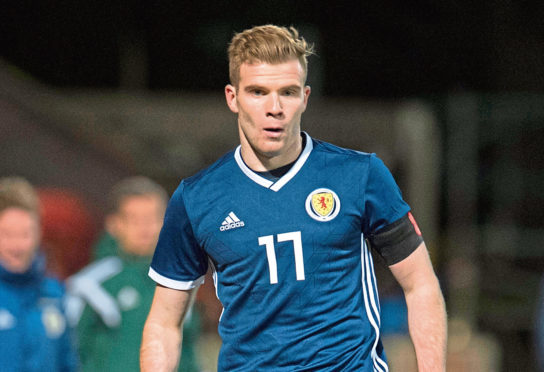 Chris Cadden in action for Scotland.