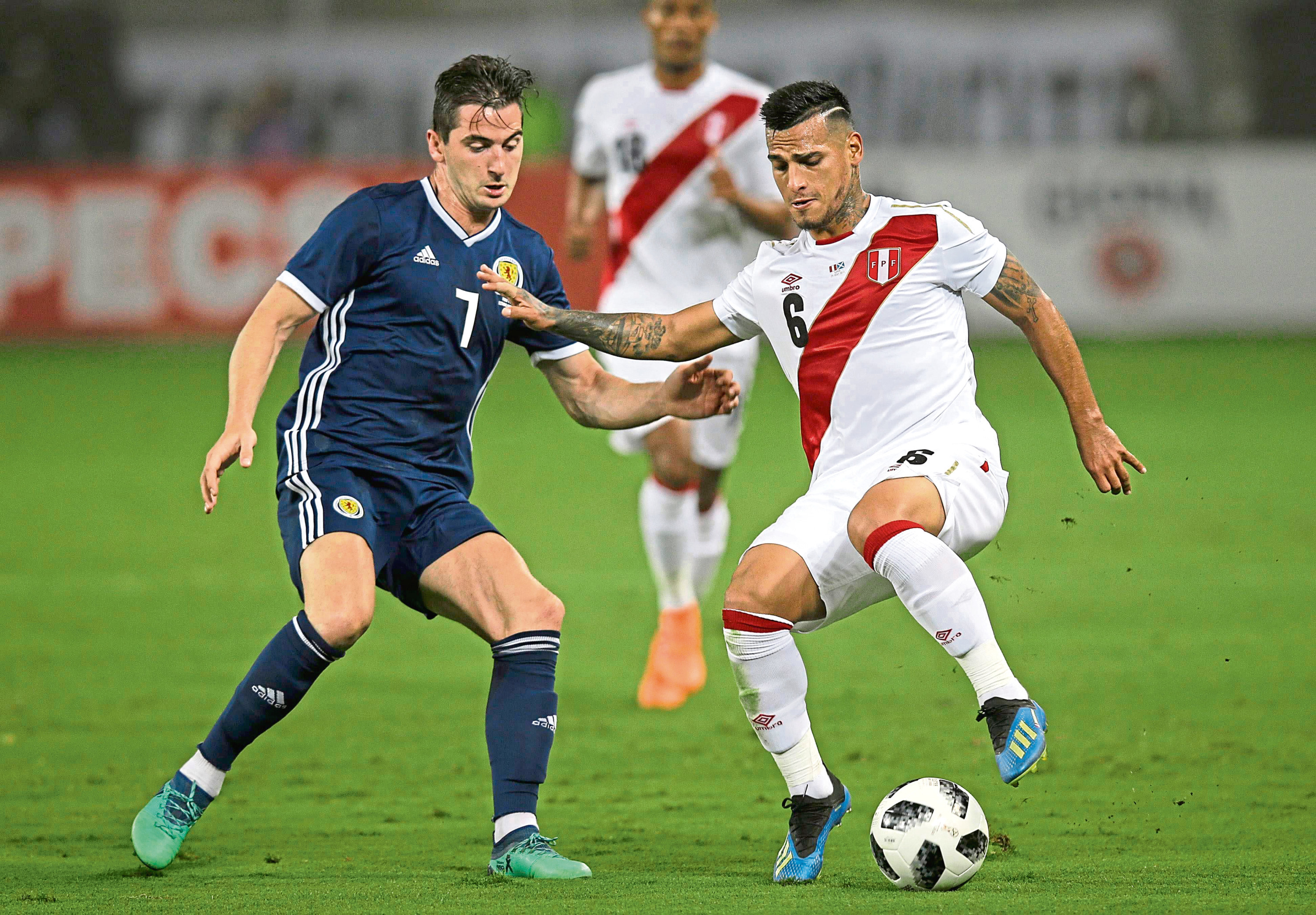 Peru's Miguel Trauco, right, fights for the ball with Scotland's Kenny McLean during a friendly soccer match in Lima, Peru, Tuesday, May 29, 2018. (AP Photo/Martin Mejia)