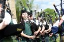 Gordon Castle Highland Games, Fochabers. The massed pipe bands perform for the crowds. Picture by Sandy McCook.
