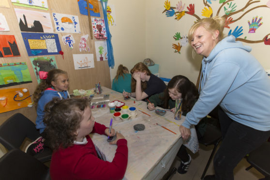 Caithness Klics project manager Wendy Thain with some of the young carers, in the art room at their Wick centre. Photo: Robert MacDonald/Northern Studios. 3 May 2018