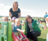 Maree Todd, right, with nursery practitioner Nicola Johnstone looking on as children take turns on a chute. Photograph by Sandy McCook