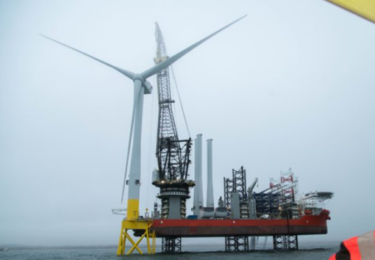 The installation of the first turbine on the European Offshore Wind Deployment Centre, off the coast of Aberdeen