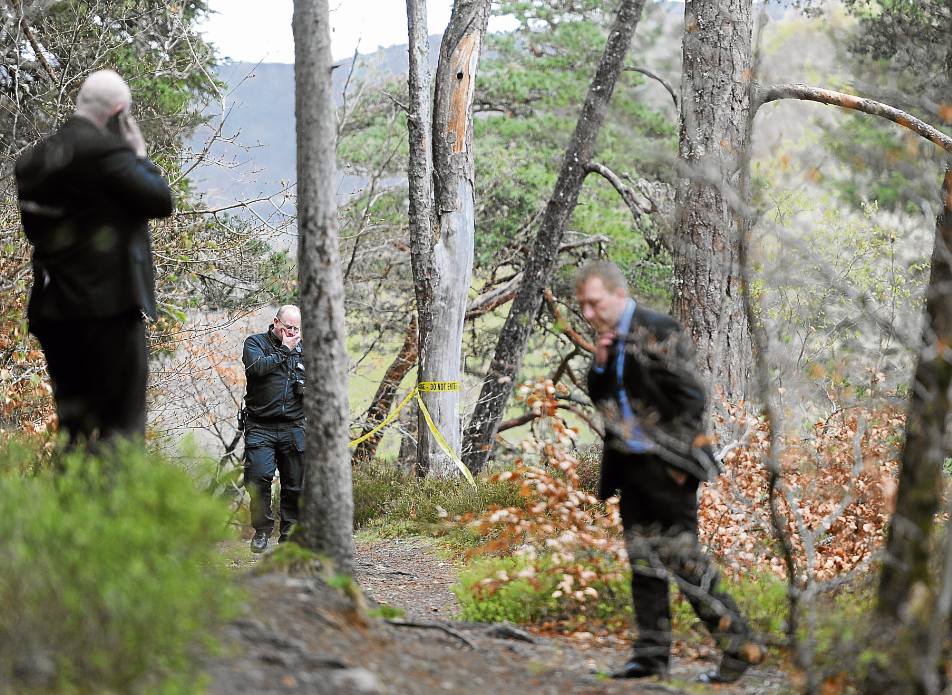 Police near the Invermoriston Falls after a woman died after falling into the river Moriston.