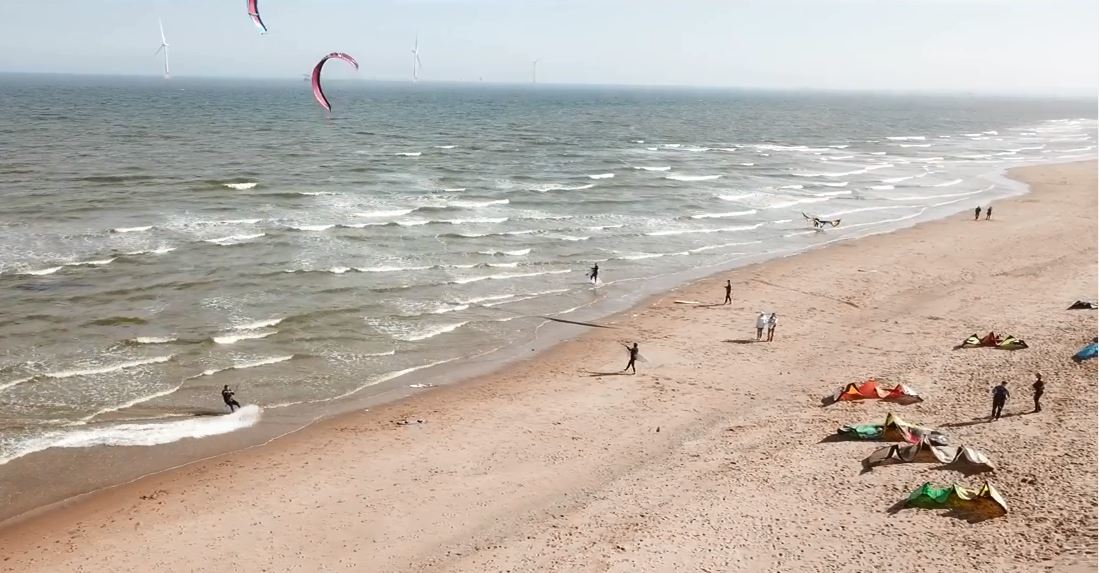 Kite surfers dance on the waves of Balmedie beach.