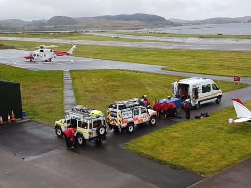 Oban Mountain Rescue and a Coastguard search and rescue Helicopter gathered at Oban Airport.