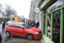 Ared Vauxhall Corsa veered onto the footpathatAberdeen's Union Terrace.