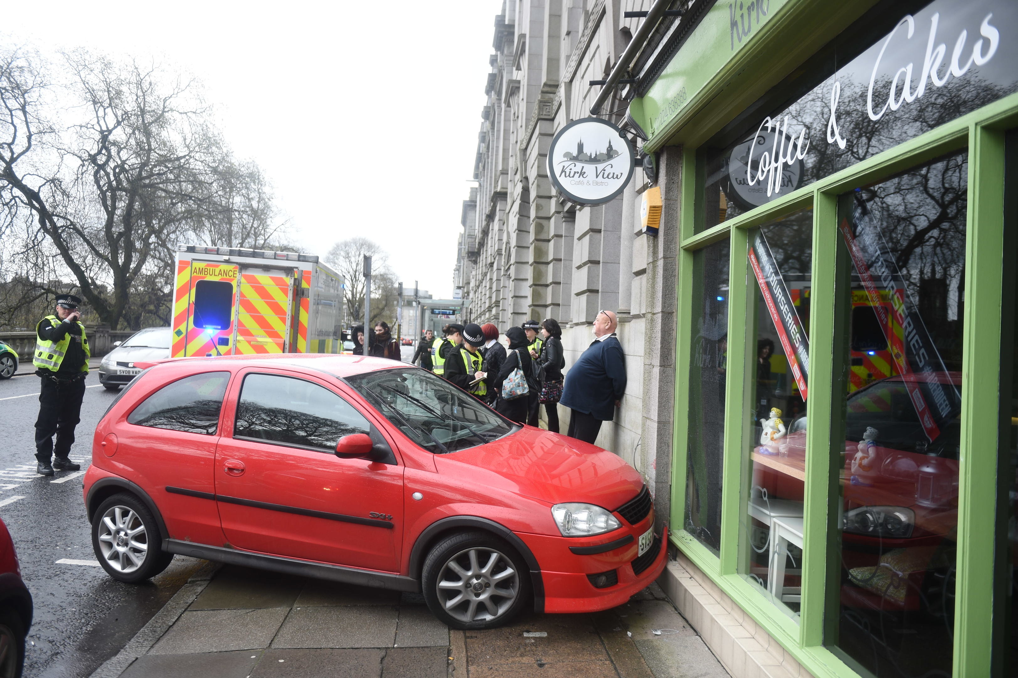 A red Vauxhall Corsa veered onto the footpath at Aberdeen's Union Terrace.
