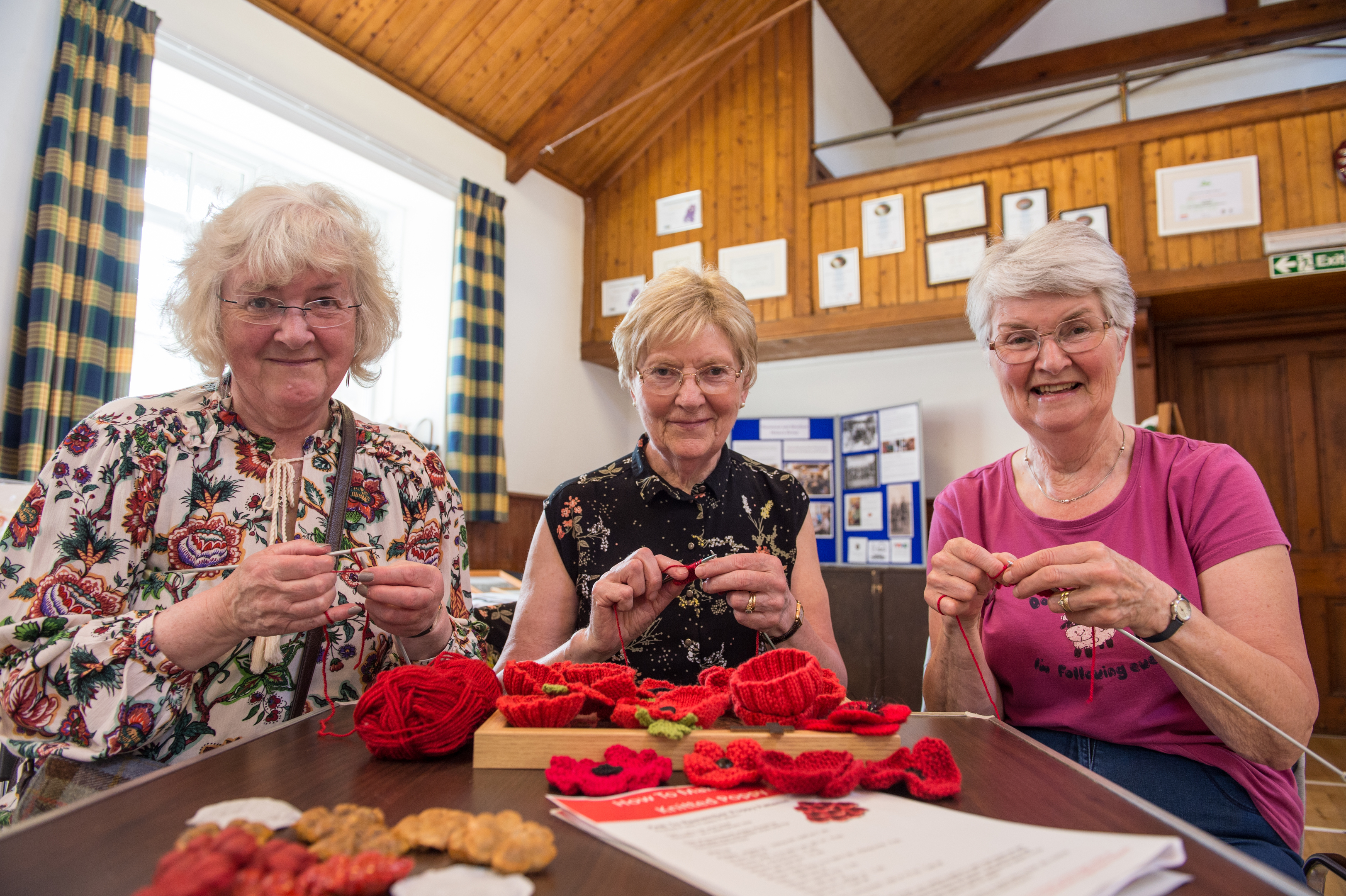 Mary Duncanson, Ethel Fowler and Anne Mathieson knit their poppies
