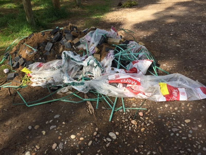 Fly-tipping reported at Lossie Forest in May 2018.